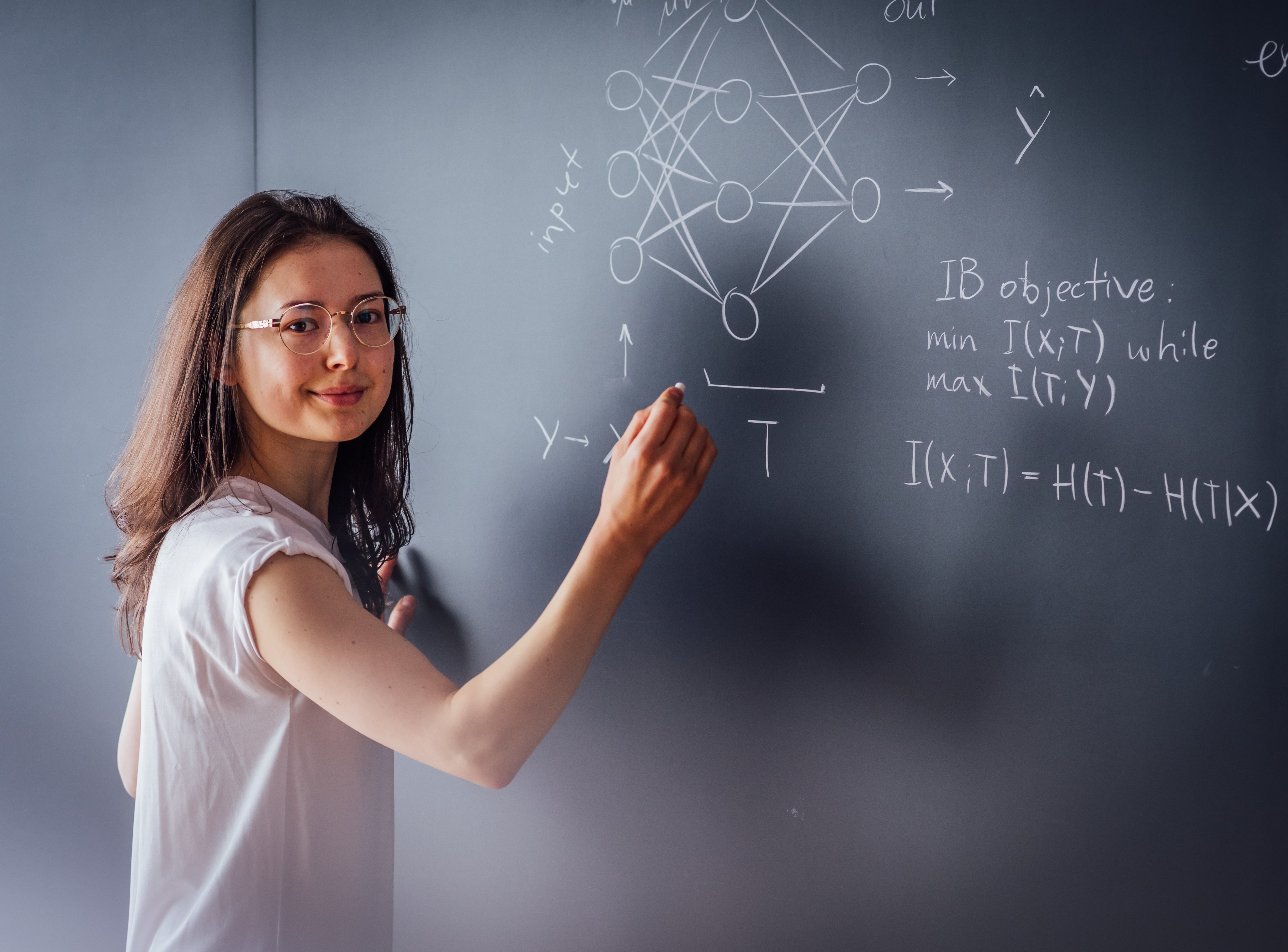 Anna Golubeva in front of a blackboard