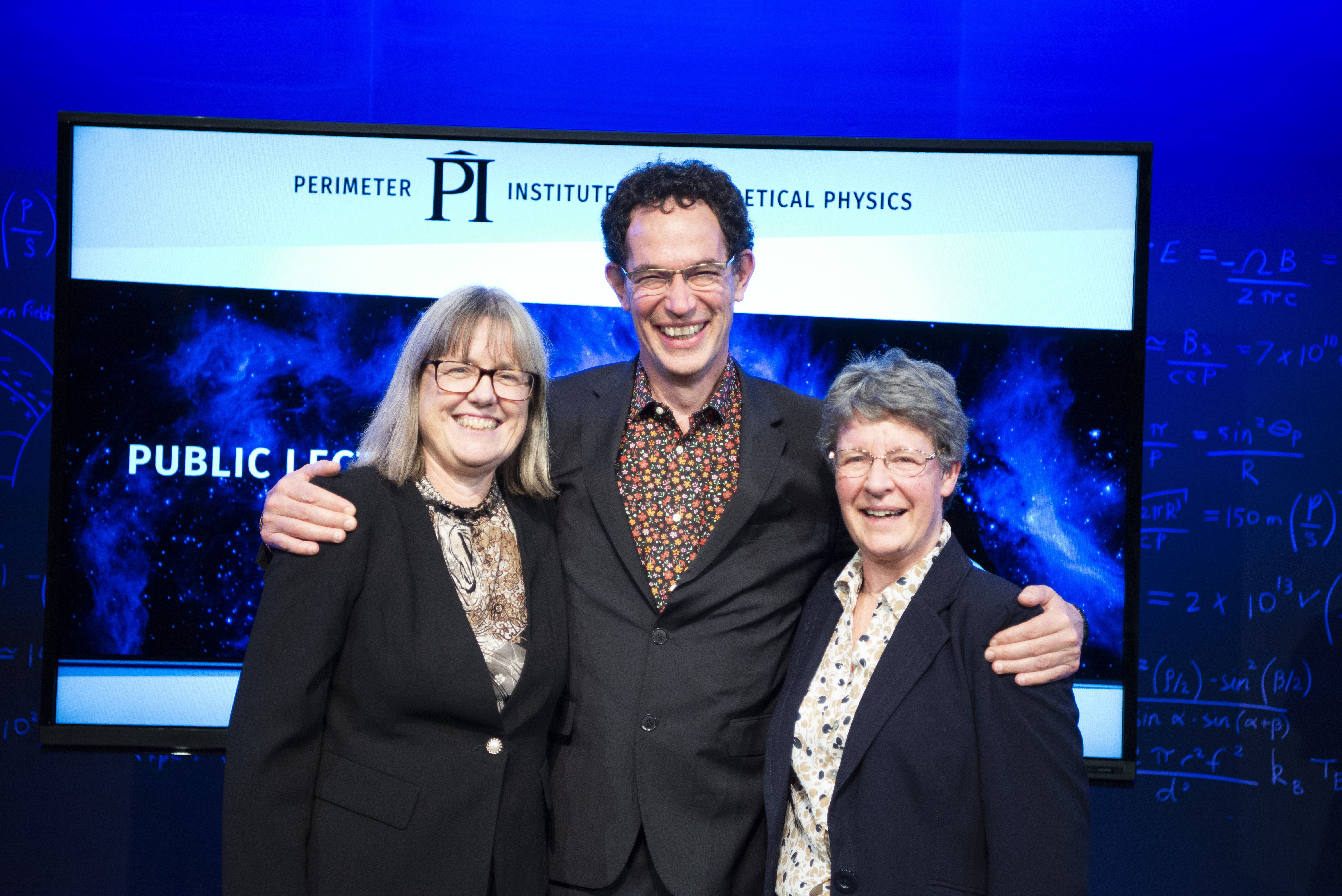 Donna Strickland, Neil Turok and Jocelyn Bell-Burnell standing together after Jocelyn's public lecture and the announcements of the new fellowships