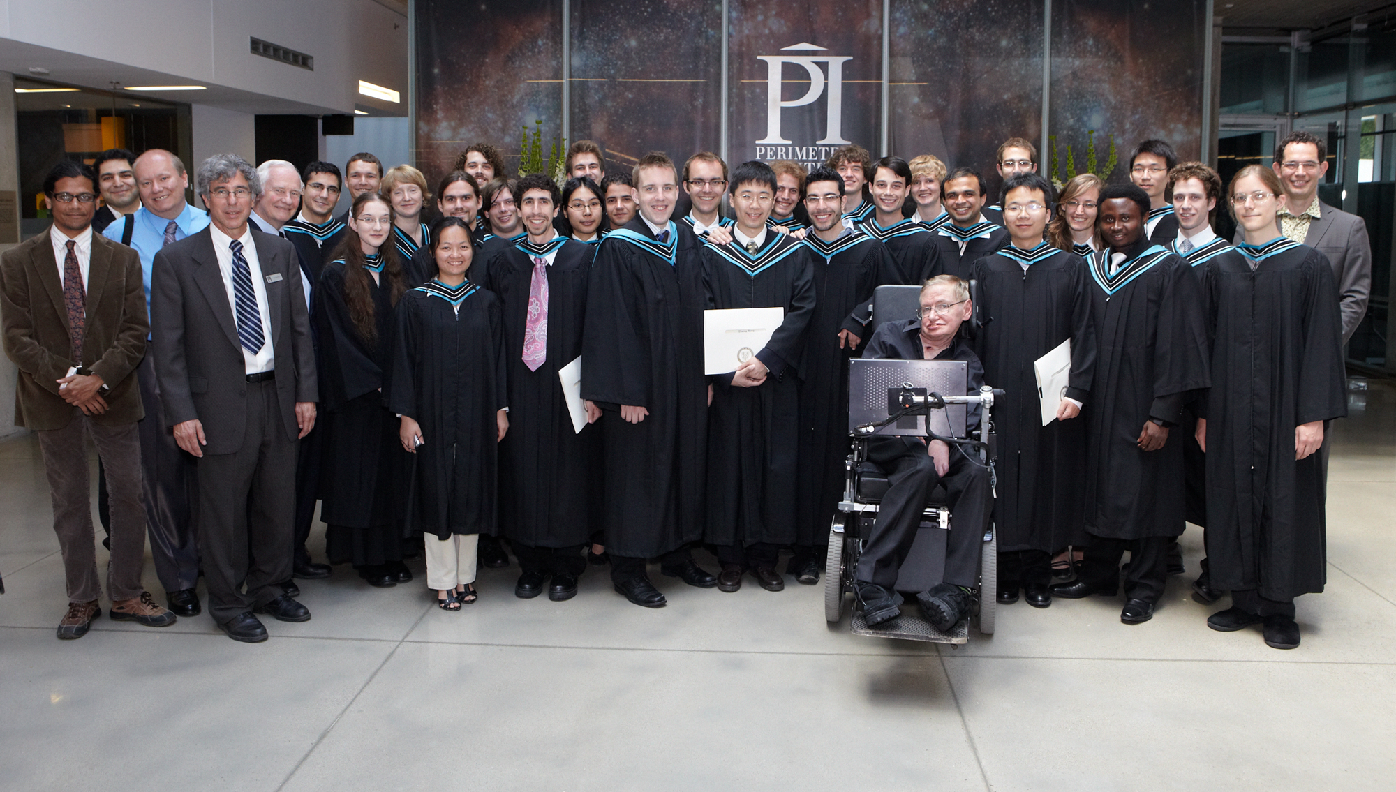 Group shot of physics students at graduation with Stephen Hawking