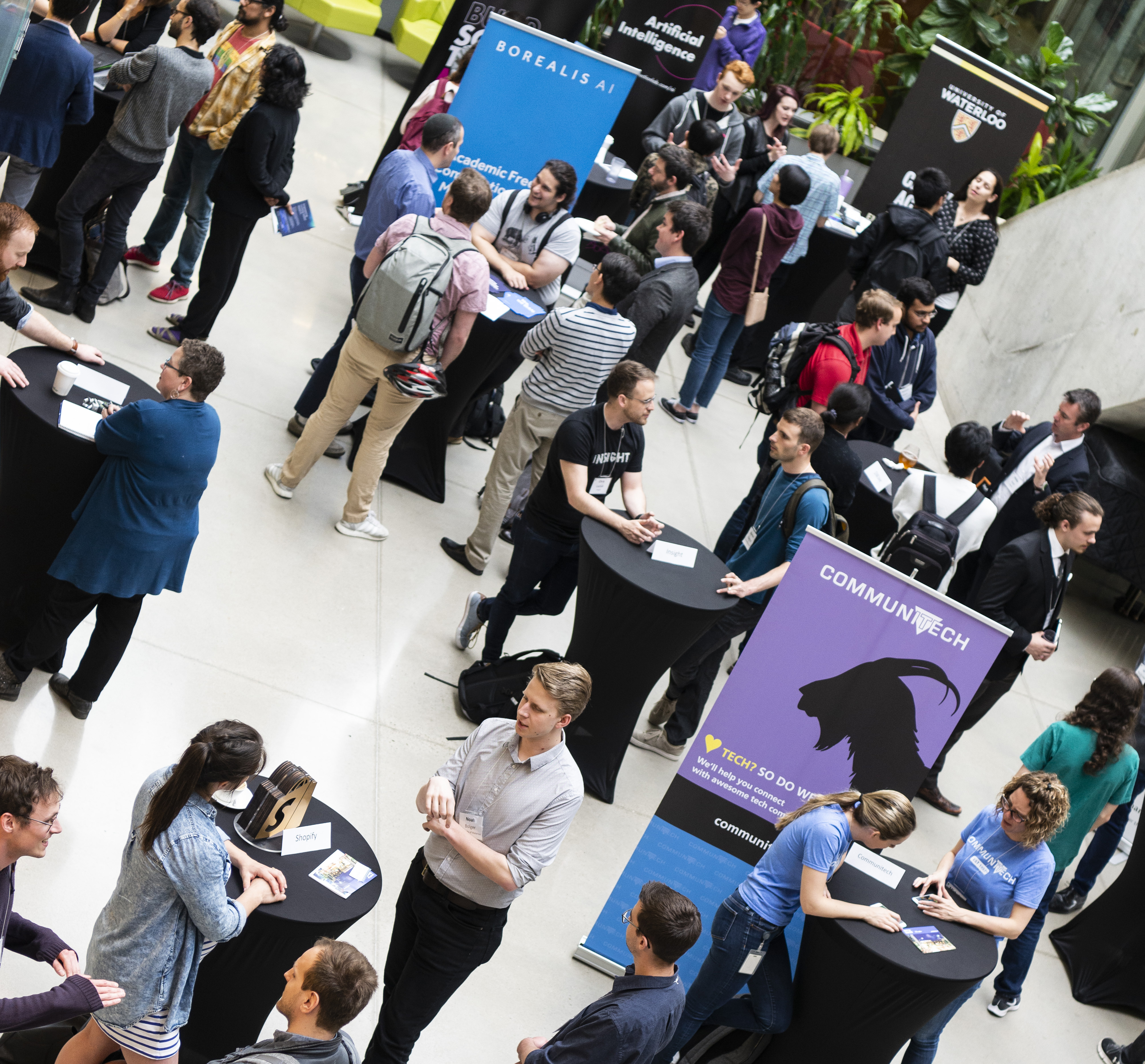 Aerial shot of people at a networking session in an atrium