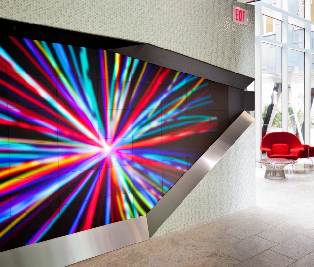 Colourful digital display in front entrance of building