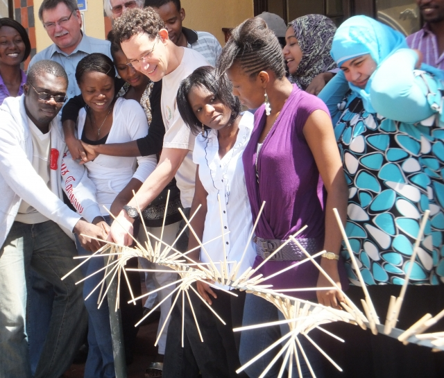 Neil Turok with people in Africa