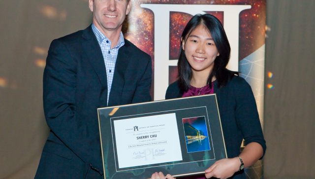 Sherry Chu receiving her Luke Santi Memorial award from Greg Dick, Perimeter's Director of Outreach